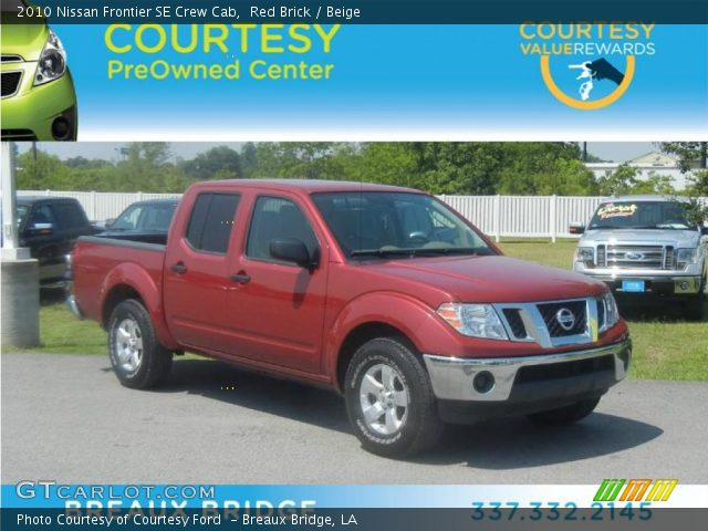 red brick 2010 nissan frontier se crew cab beige interior vehicle archive. Black Bedroom Furniture Sets. Home Design Ideas