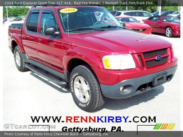 red fire metallic 2004 ford explorer sport trac xlt 4x4 medium dark flint dark flint. Black Bedroom Furniture Sets. Home Design Ideas