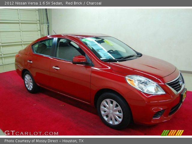 red brick 2012 nissan versa 1 6 sv sedan charcoal. Black Bedroom Furniture Sets. Home Design Ideas
