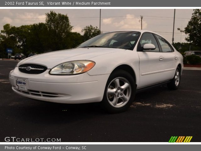 vibrant white 2002 ford taurus se medium parchment. Black Bedroom Furniture Sets. Home Design Ideas