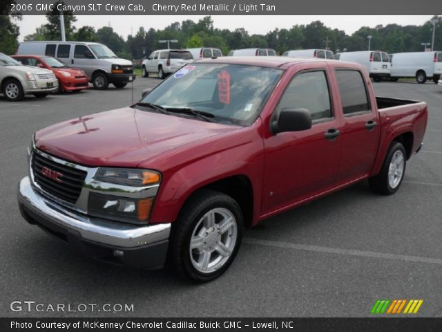 cherry red metallic 2006 gmc canyon slt crew cab light tan interior vehicle. Black Bedroom Furniture Sets. Home Design Ideas