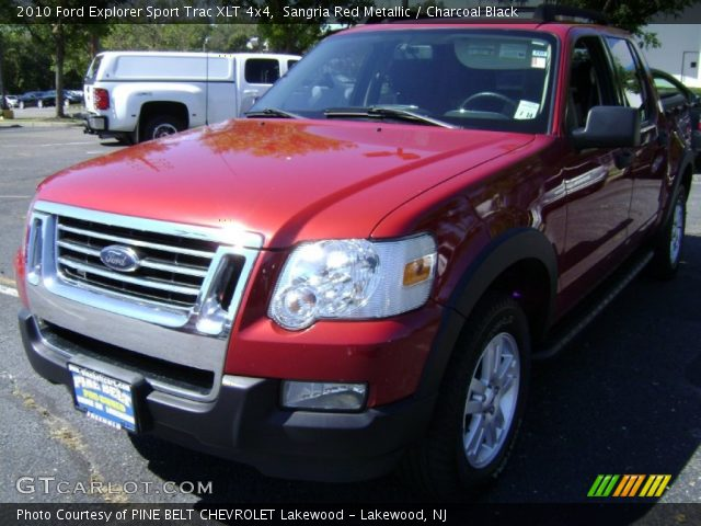 sangria red metallic 2010 ford explorer sport trac xlt 4x4 charcoal black interior. Black Bedroom Furniture Sets. Home Design Ideas