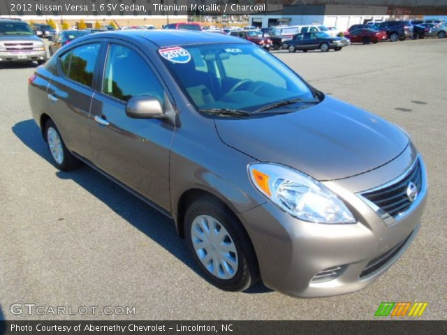 titanium metallic 2012 nissan versa 1 6 sv sedan charcoal interior vehicle. Black Bedroom Furniture Sets. Home Design Ideas