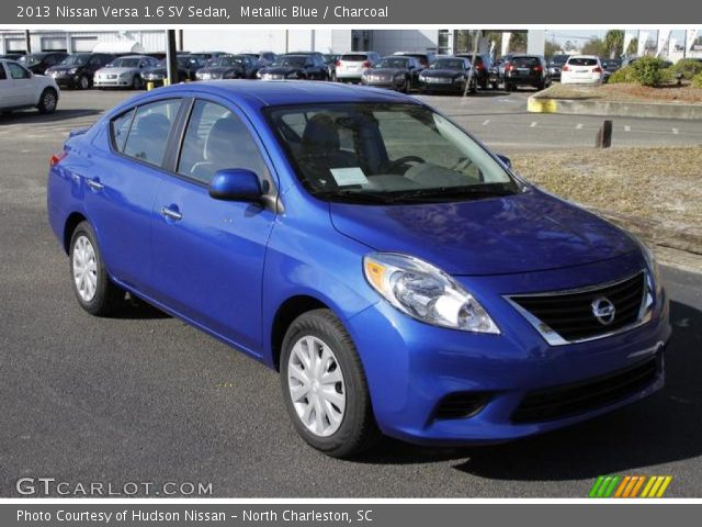 metallic blue 2013 nissan versa 1 6 sv sedan charcoal interior vehicle. Black Bedroom Furniture Sets. Home Design Ideas