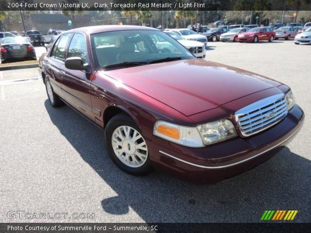 Dark toreador red metallic 2004 ford crown victoria lx for Crown motors ford redding