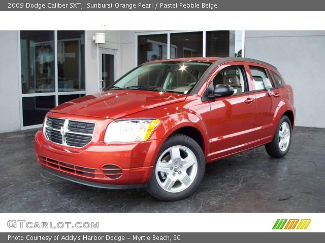 Sunburst Orange Pearl 2009 Dodge Caliber SXT with Pastel Pebble Beige