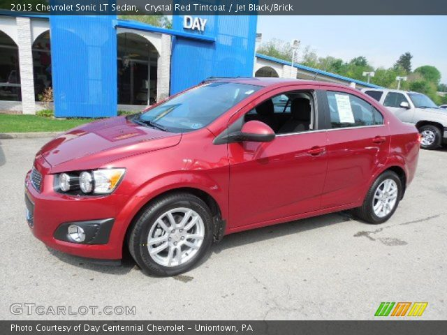 on 2013 Chevy Sonic Lt Sedan Red