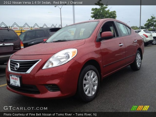 red brick 2012 nissan versa 1 6 sv sedan charcoal interior vehicle archive. Black Bedroom Furniture Sets. Home Design Ideas