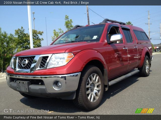 red brick 2009 nissan frontier le crew cab 4x4 beige interior vehicle. Black Bedroom Furniture Sets. Home Design Ideas