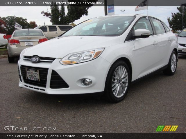 oxford white 2012 ford focus sel sedan charcoal black interior vehicle. Black Bedroom Furniture Sets. Home Design Ideas