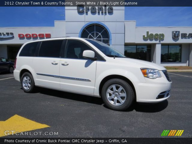 Stone white 2012 chrysler town country touring black for Stone s town country motors
