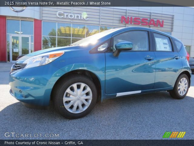 metallic peacock 2015 nissan versa note sv wheat stone interior vehicle. Black Bedroom Furniture Sets. Home Design Ideas