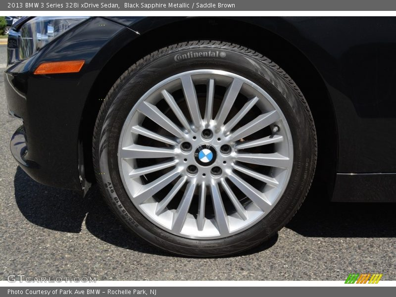 Black Sapphire Metallic / Saddle Brown 2013 BMW 3 Series 328i xDrive Sedan