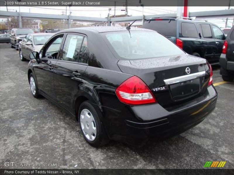 2009 nissan versa 1 8 s sedan in super black photo no 25461087. Black Bedroom Furniture Sets. Home Design Ideas