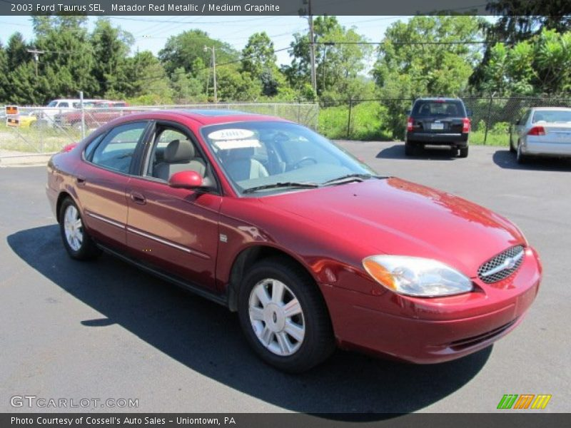 2003 ford taurus sel in matador red metallic photo no. Black Bedroom Furniture Sets. Home Design Ideas