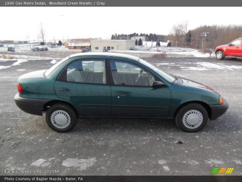 Woodland Green Metallic / Gray 1996 Geo Metro Sedan