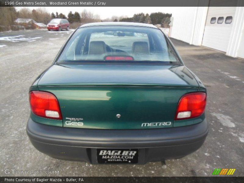 Woodland Green Metallic / Gray 1996 Geo Metro Sedan