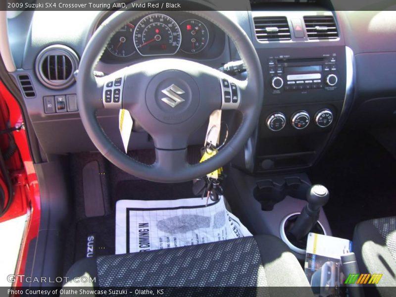 Vivid Red / Black 2009 Suzuki SX4 Crossover Touring AWD