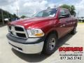 2012 Deep Molten Red Pearl Dodge Ram 1500 ST Quad Cab  photo #1