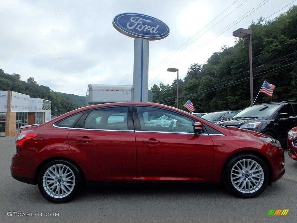 2014 ruby red ford focus titanium sedan 115350309