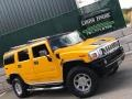 Yellow 2005 Hummer H2 SUV