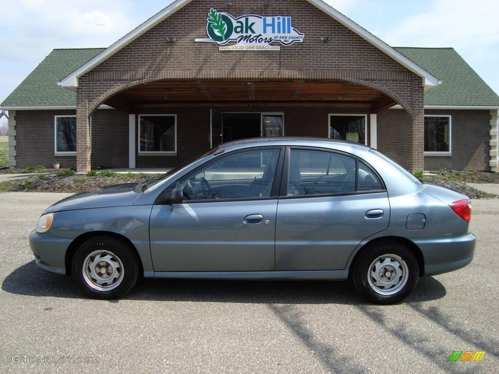 2001 rio sedan steel blue metallic gray photo 1