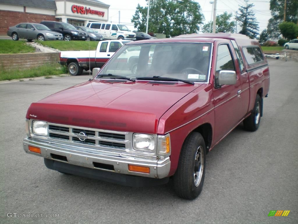 Cherry Red Pearl Nissan Hardbody Truck