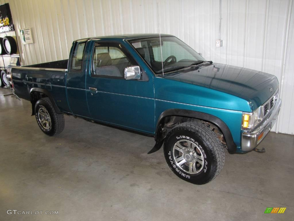 1997 hardbody truck xe extended cab 4x4 vivid teal pearl metallic dark gray photo
