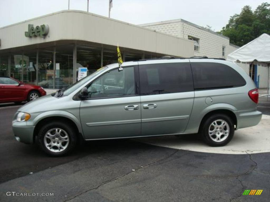 2004 grand caravan sxt awd satin jade green pearl medium slate gray photo