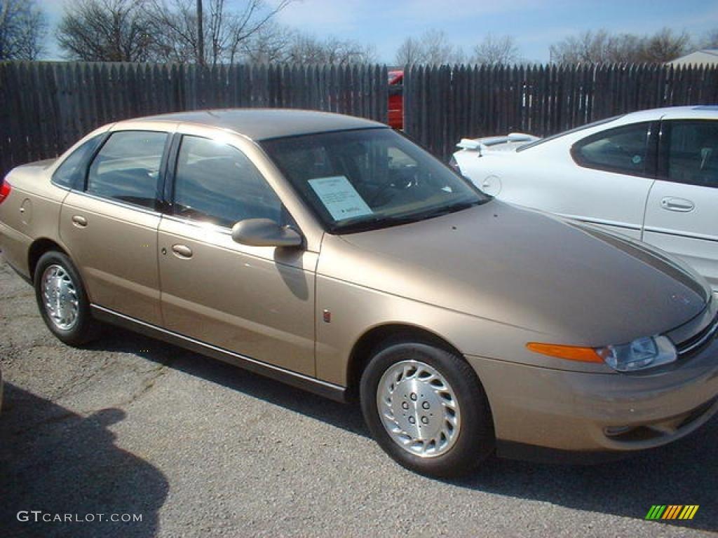 2001 medium gold saturn l series l300 sedan 14988833 photo 2 2001 l series l300 sedan medium gold tan photo 2 vanachro Image collections