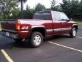 2000 Dark Carmine Red Metallic Chevrolet Silverado 1500 LS Extended Cab 4x4  photo #16