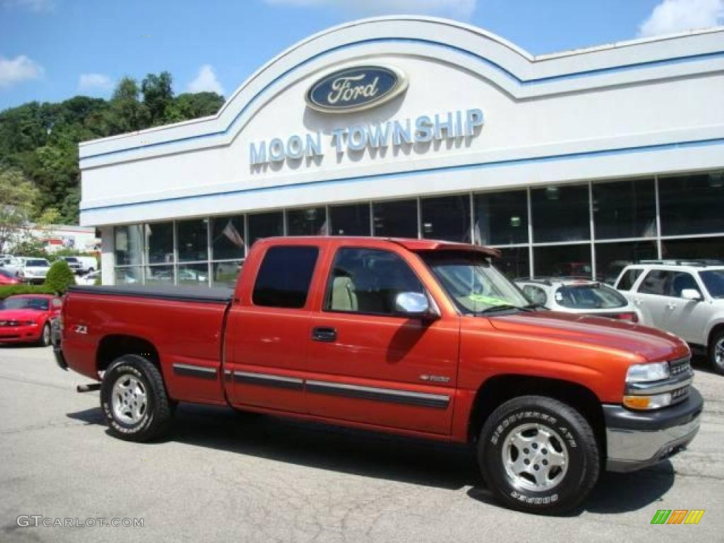 2001 Silverado 1500 LS Extended Cab 4x4 - Sunset Orange Metallic / Tan photo #1