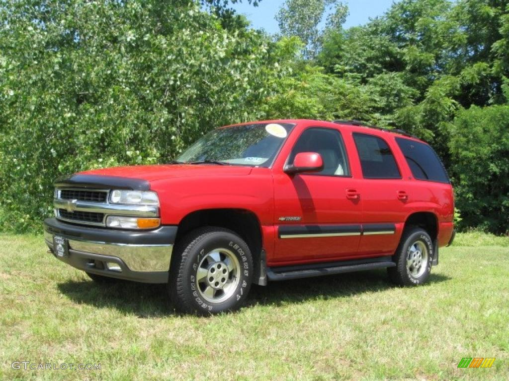 Victory red chevrolet tahoe