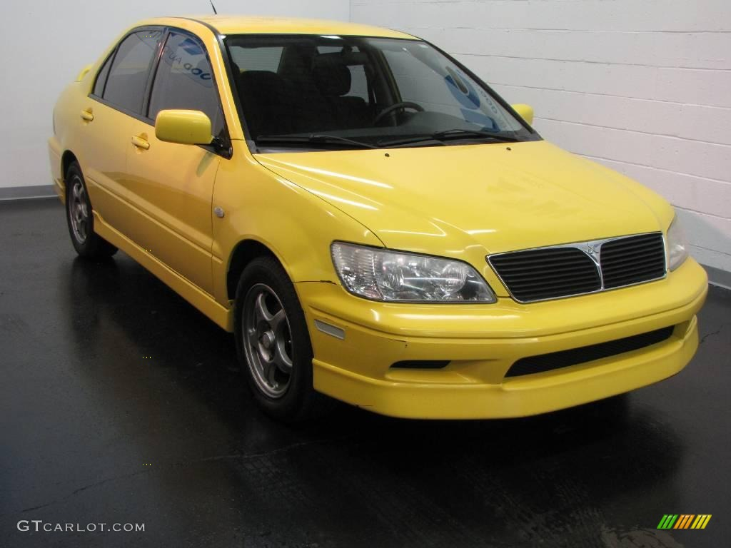 2002 lightning yellow mitsubishi lancer oz rally 16687043. Black Bedroom Furniture Sets. Home Design Ideas