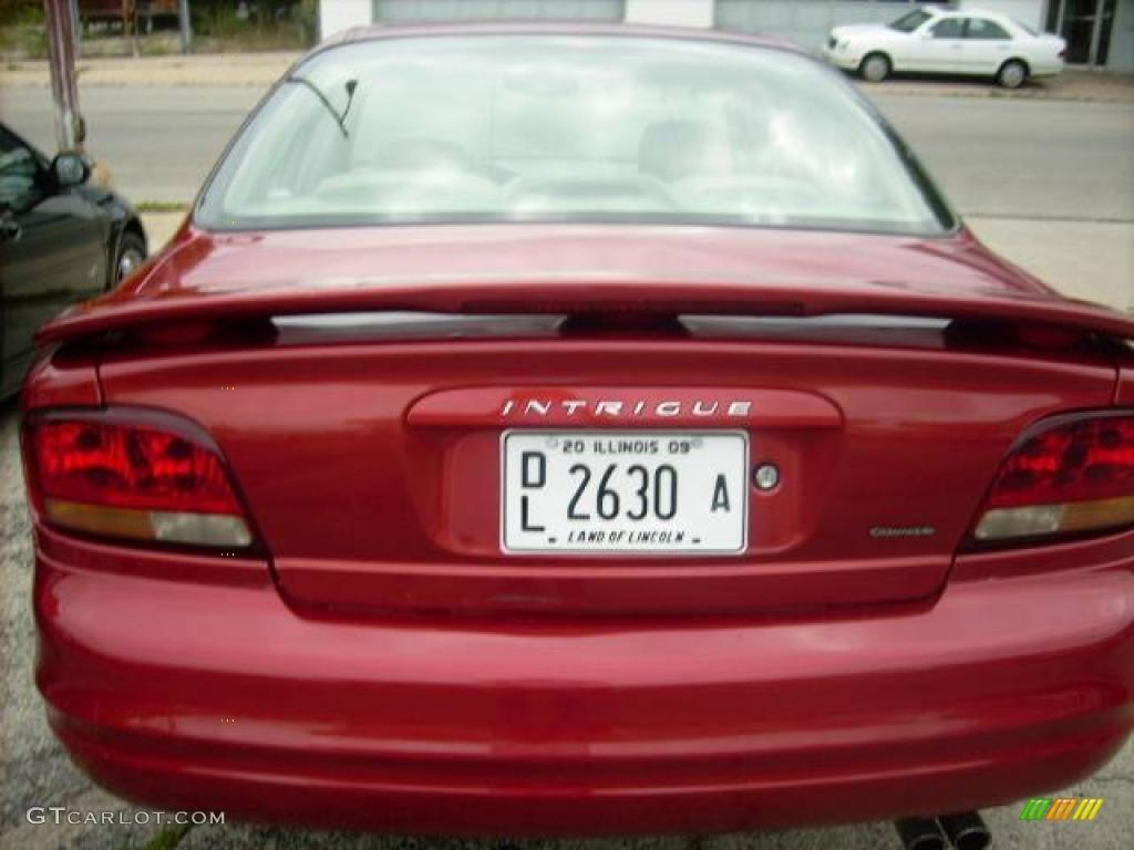 Crimson red metallic oldsmobile intrigue