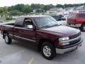 2000 Dark Carmine Red Metallic Chevrolet Silverado 1500 LS Extended Cab 4x4  photo #21