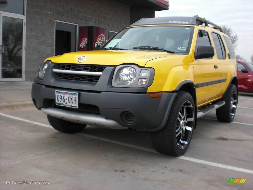2004 xterra xe solar yellow charcoal photo 1