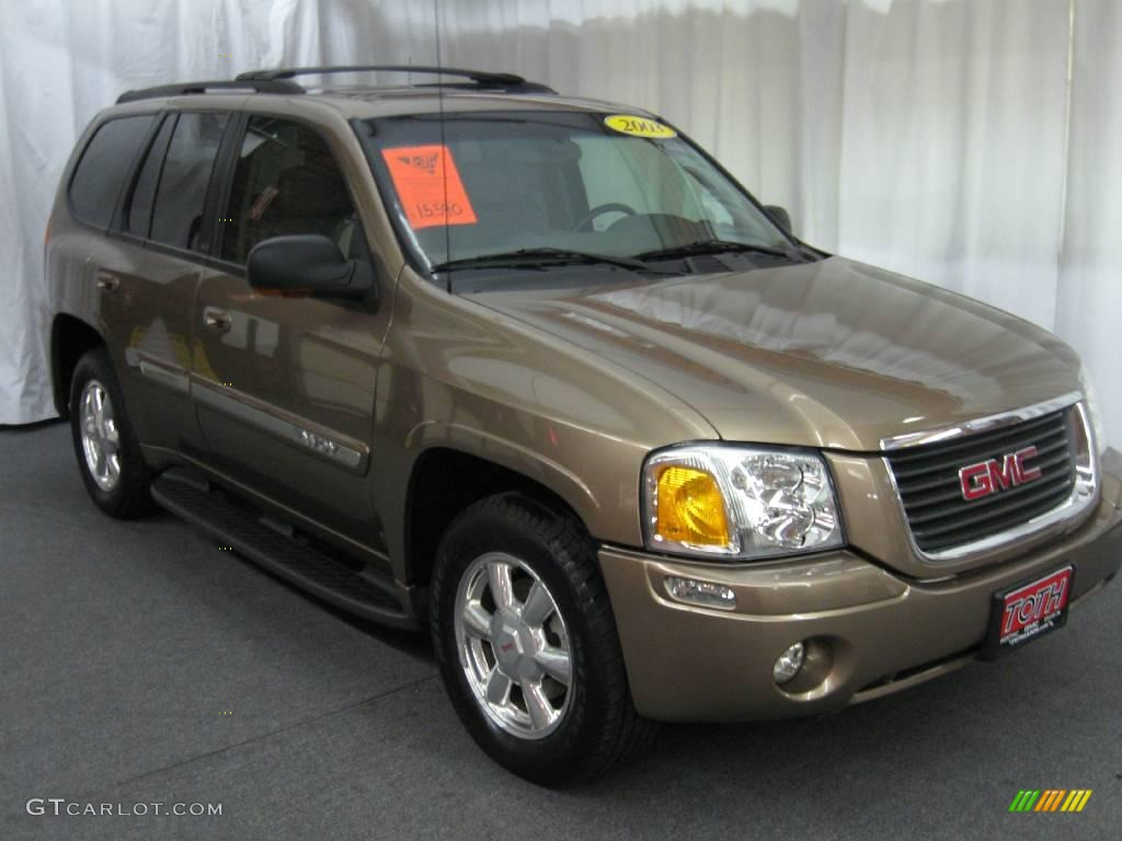 2003 sandalwood metallic gmc envoy slt 4x4 20456712 photo. Black Bedroom Furniture Sets. Home Design Ideas