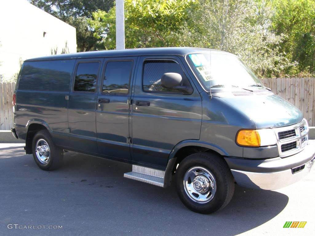 Dark spruce metallic dodge ram van