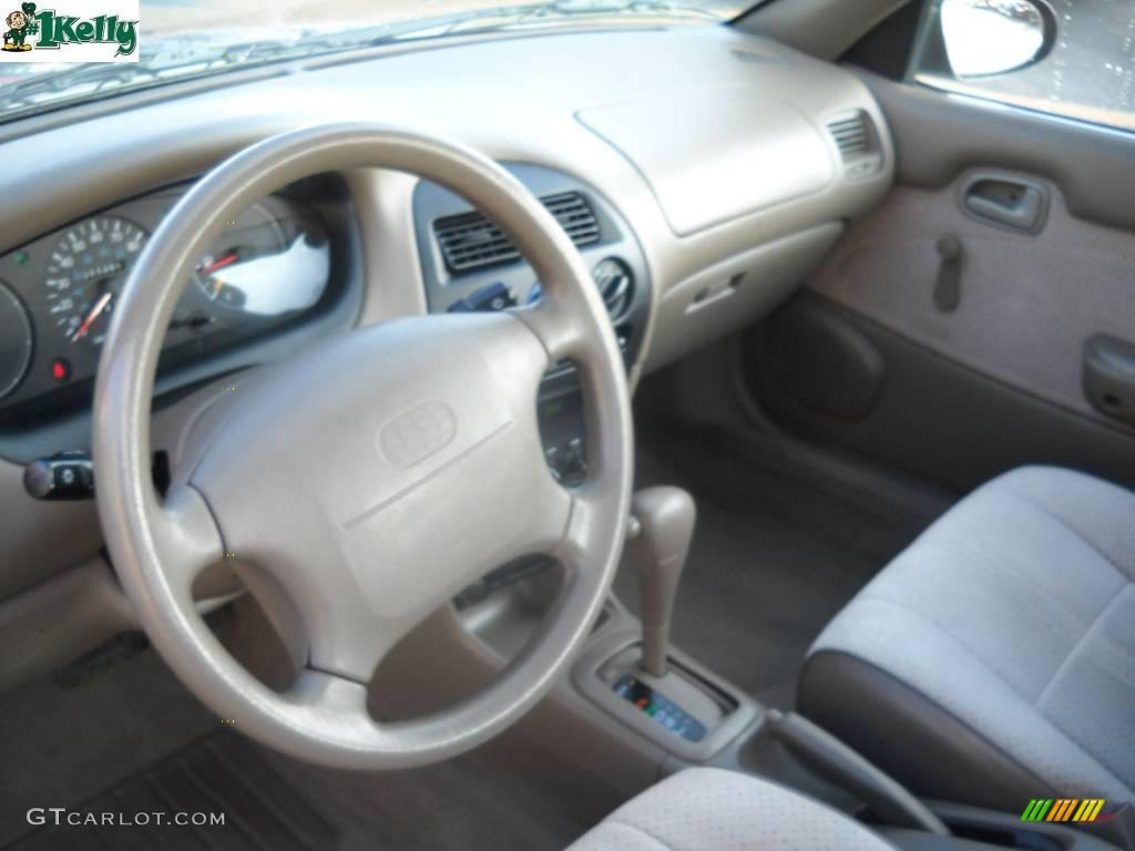 Beige Interior 1995 Geo Prizm Standard Prizm Model Photo  22802675