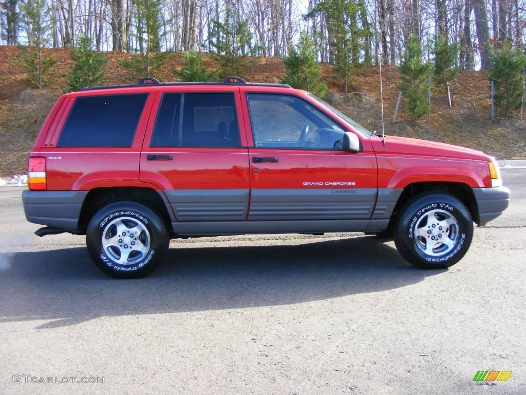 1997 jeep grand cherokee laredo 4x4 flame red color agate black