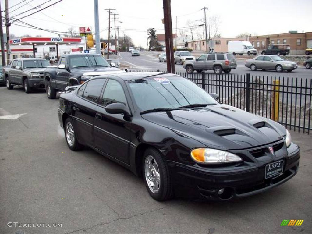 2002 black pontiac grand am gt sedan 23770314 gtcarlot. Black Bedroom Furniture Sets. Home Design Ideas