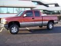 2001 Sunset Orange Metallic Chevrolet Silverado 1500 LS Extended Cab 4x4 #24138674