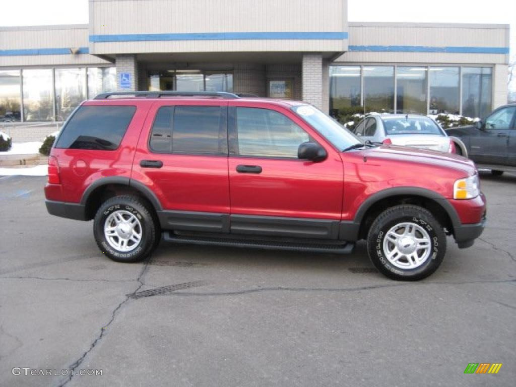 2003 Explorer XLT AWD - Redfire Metallic / Graphite Grey photo #1