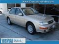 Sunlit Sand Metallic 1999 Nissan Maxima SE