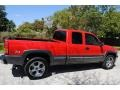 2000 Victory Red Chevrolet Silverado 1500 LS Extended Cab 4x4  photo #8
