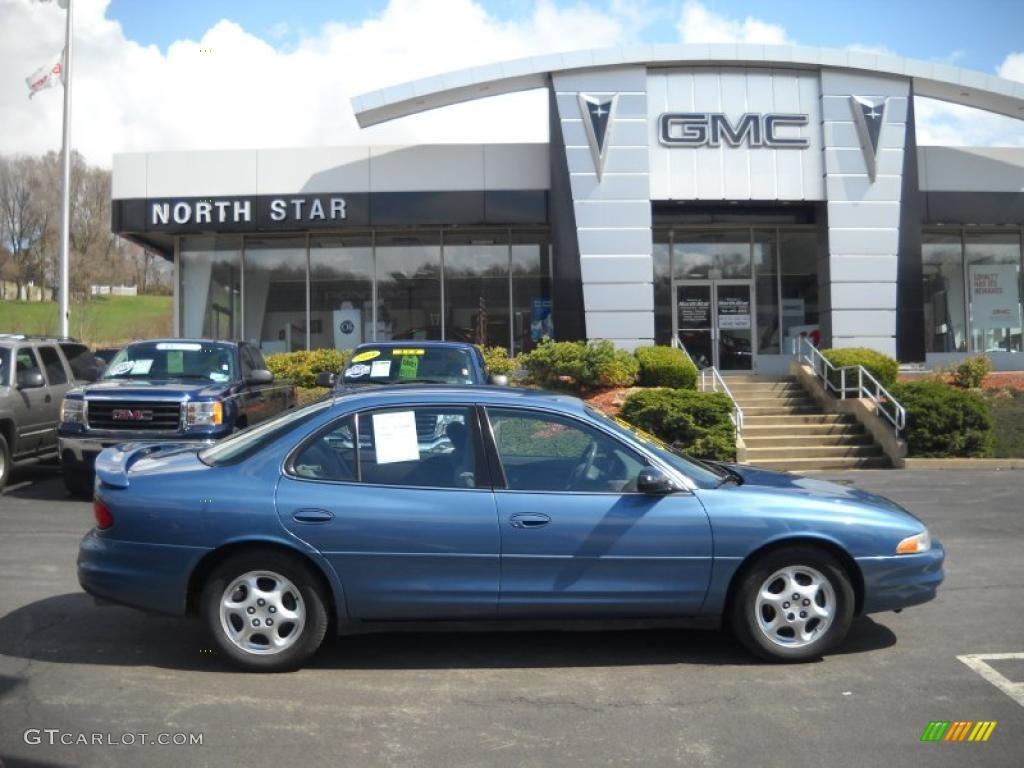 Blue metallic oldsmobile intrigue