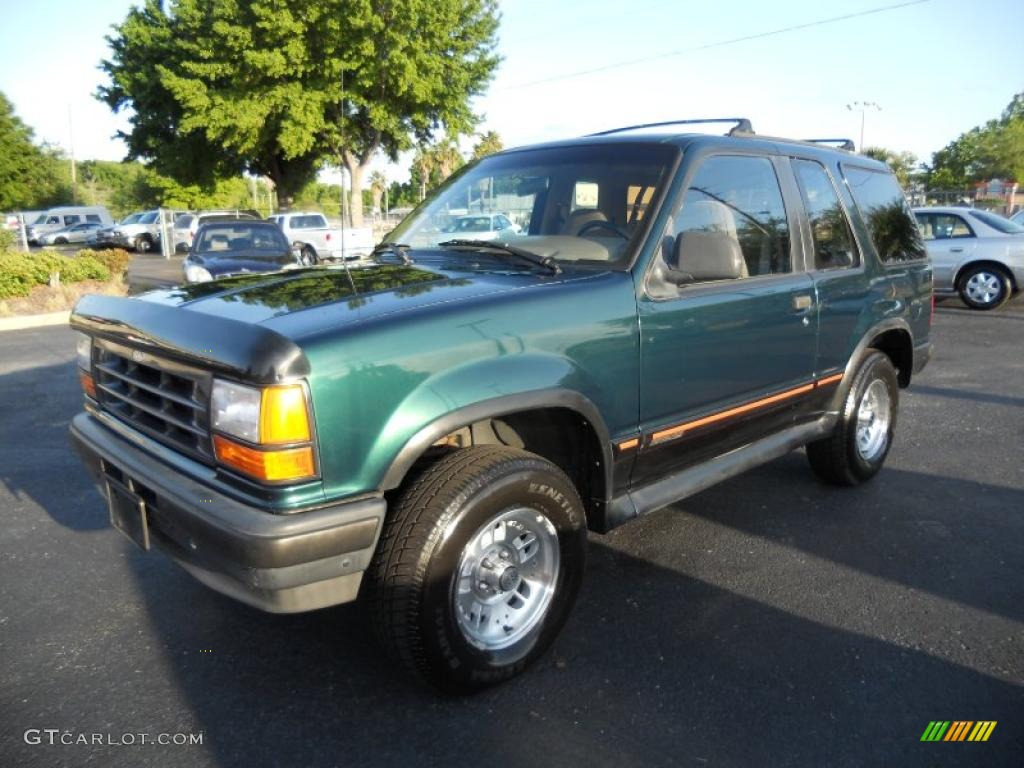 Deep emerald green metallic ford explorer