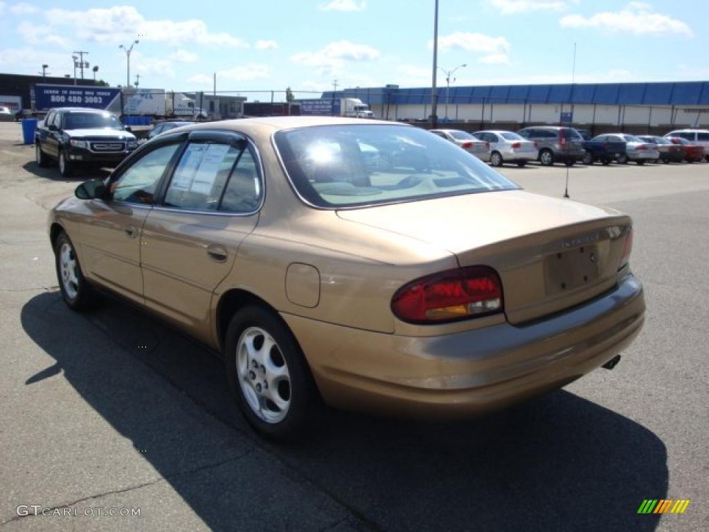 1998 intrigue gold metallic beige photo 2