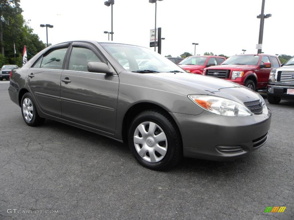 Watch as well 1997 Toyota Camry Pictures C4041 likewise Interior 58344593 as well Wheel 78370810 additionally Trunk 47061881. on 2003 toyota camry se v6